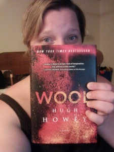 Ashley, holding a copy of Wool by Hugh Howey